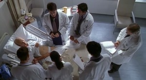 A still from the Grand Rounds scene in which Dr. Bearing's body is used as a text. Photo Credit: HBO Films 2001