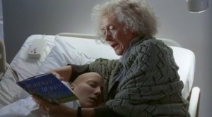 "Dr. Ashford reads ""Vivian."" Photo Credit: HBO Films, 2001"